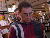 Brian Rappatta prepares to read his story in Barnes & Noble. M. C. DeMarco at left. Roger Bagwell, graduate of Odyssey 2003, in background.